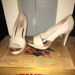 Nude and rose gold open toed heels.